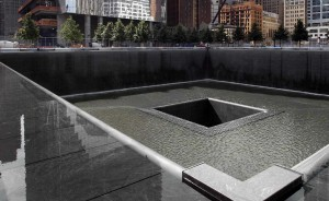 A general view shows the south pool waterfall as work continues on the National September 11 Memorial and Museum at the World Trade Center site in New York July 28, 2011. The memorial is scheduled to be dedicated on September 11, 2011, the 10th anniversary of the attacks on the World Trade Center. REUTERS/Mike Segar (UNITED STATES - Tags: DISASTER SOCIETY CITYSCAPE)